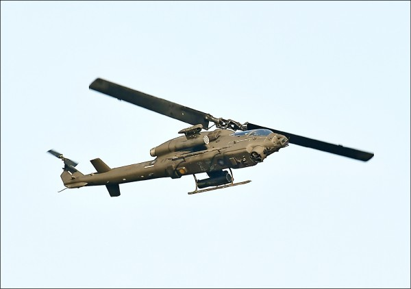 眼鏡蛇直升機進行地面攻擊防衛。(資料照)