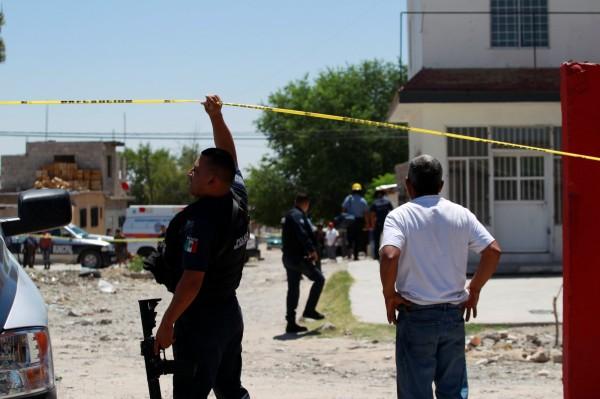 墨西哥北部華瑞茲城(Ciudad Juarez)今驚傳3起槍擊事件,造成14人死亡、3人受傷。(路透)