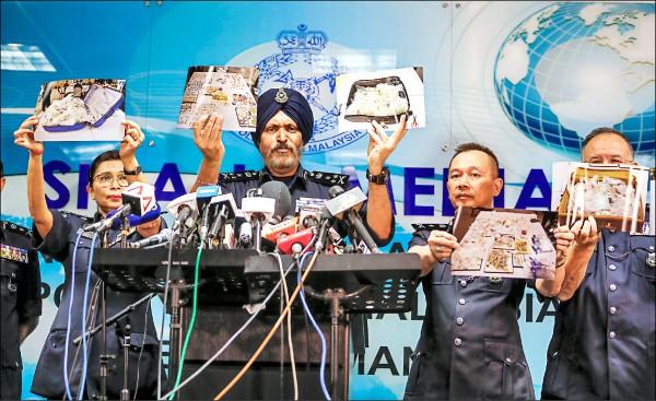 圖為大馬警方商業犯罪調查組組長阿瑪爾在記者會上公布前述物品的照片。(歐新社)