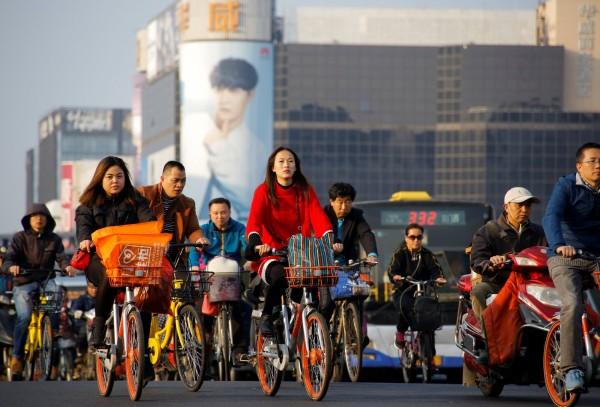 中國近年推行社會信用系統大肆監控,有澳洲學者發表研究指出,嚴重到可能干涉他國主權。(路透)