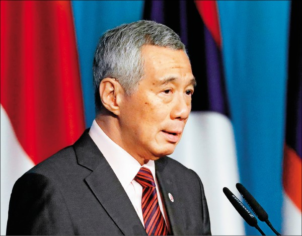 新加坡150萬人病歷遇駭,李顯龍也受害。(美聯社檔案照)