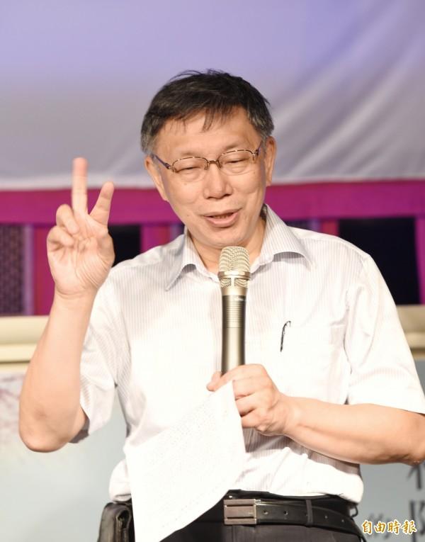 台北市長柯文哲表示,現在自己反而變成「學姊」的隨扈了。(記者方賓照攝)