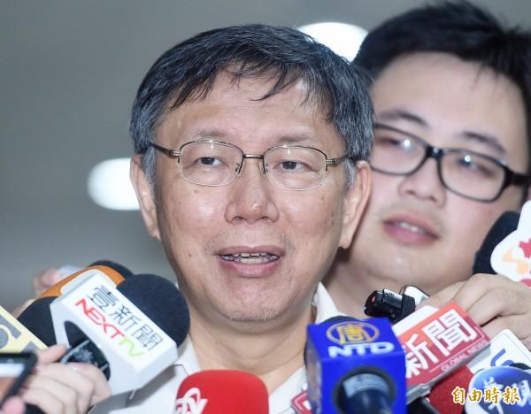 台北市長柯文哲拚連任,日前宣布將推「柯P認同卡」,要先認同他的理念才能同台合照。(資料照)