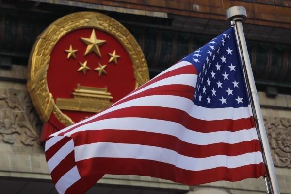 中國人民大學國際關係學院副院長金燦榮談中美貿易戰,「不把你分為7個中國,它(美)不會放手」。(美聯社)