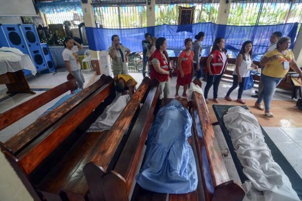 土石流釀12人死亡,50人以上下落不明。(美聯社)
