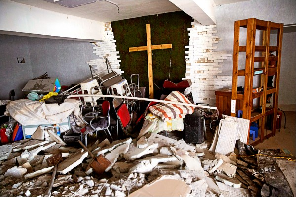 中國各地近來湧現新一輪打壓天主教與新教的浪潮,河南省鄭州市今年六月就有教堂遭當局拆毀。(美聯社檔案照)
