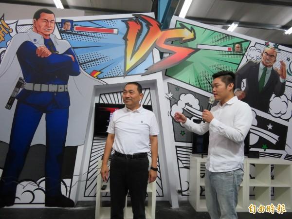 侯友宜競選總部規劃的電玩區,背板以「鐵捕猴vs.火球蘇」設計,引發聯想。(記者何玉華攝)
