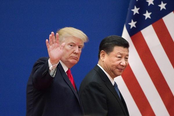 中美貿易戰已持續進行一段時間,雙方都不斷在政策上攻擊對方。(法新社)