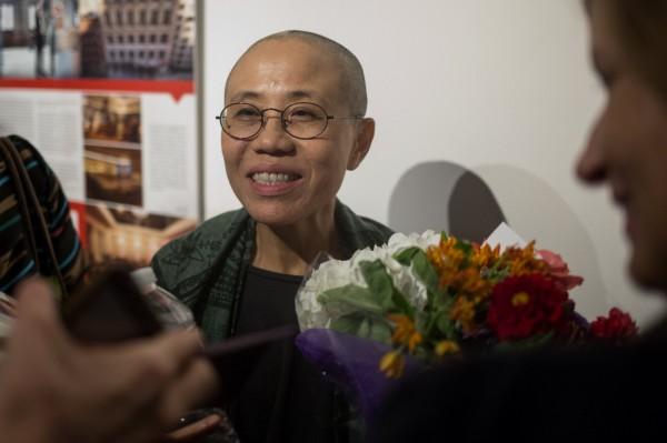 今天有媒體報導,余杰透露劉霞明年可能會來台辦攝影展。(路透)