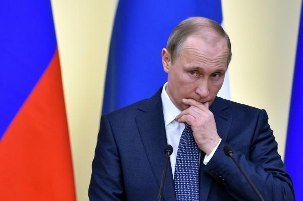 俄國降低美元外匯存底比率,提高人民幣佔比,在美中貿易戰開打後慘賠22億美元。(法新社)