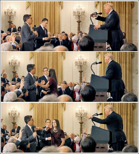 美國總統川普七日在白宮記者會上,與CNN記者阿科斯達口角,川普要求對方交出麥克風,白宮女實習生一度上前欲將麥克風拿走但未成功。(路透)