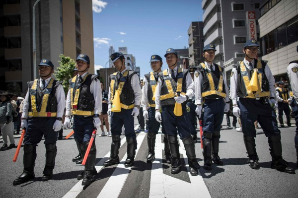 圖為日本警察。(法新社)