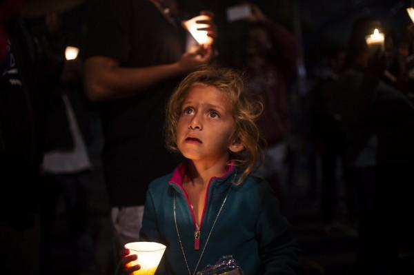 圖為滯留在墨西哥邊境城市蒂華納(Tijuana)的難民女童。(法新社)
