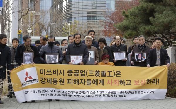 南韓最高法院今天(29日)勒令日本三菱重工必須賠償5名戰時勞工家屬及勤勞挺身隊女性。(美聯社)