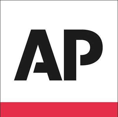 美聯社執行長普魯特(Gary Pruitt)11月底前往北京會見新華社社長蔡明照,雙方協議展開合作,卻引發美國國會關切。(圖擷取自臉書AP)