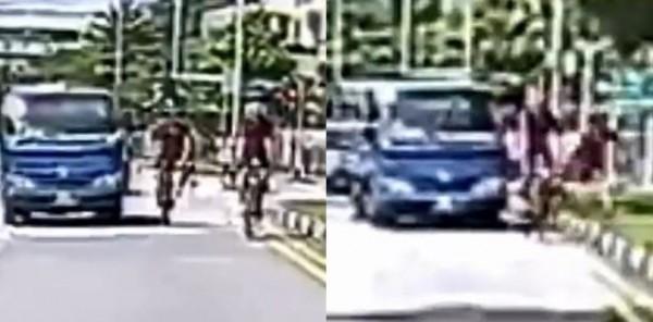 單車騎士拍打貨車照後鏡,被司機撞去路邊。(圖擷取自影片)