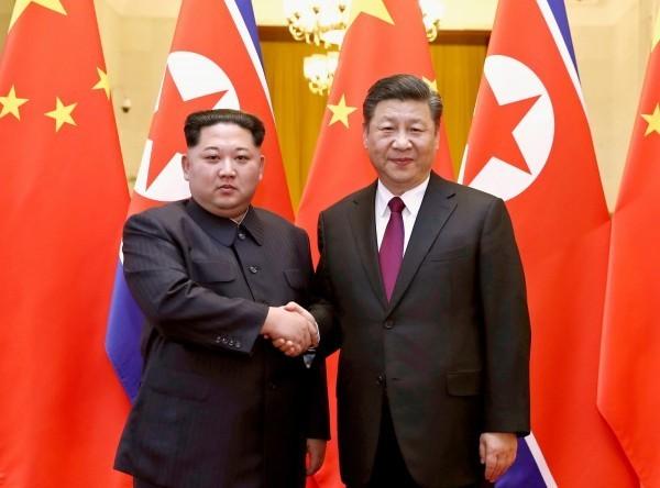 去年3月至今,金正恩已與習近平四度會面。(美聯社檔案照)