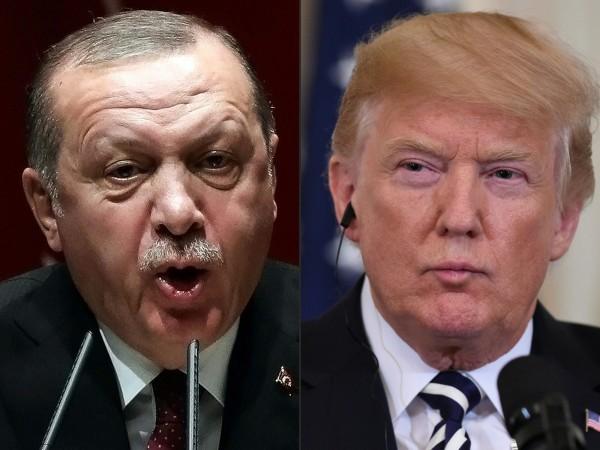 在兩國數天的協調之後,土耳其今日宣布,會在敘利亞北部建立1個「安全區」。圖左為土耳其總統艾多根,圖右為美國總統川普。(法新社)