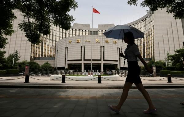 中國經濟數據灌水,官員升官。(路透)