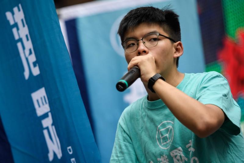 香港眾志秘書長黃之鋒表示,香港政府藉由修改引渡制度,讓到香港旅遊的台灣人恐怕變成下一個李明哲。(法新社資料照)