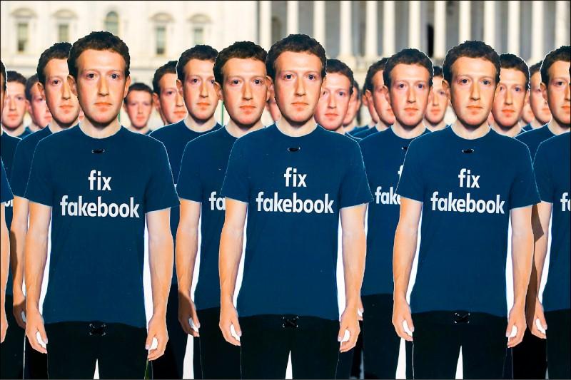 數十座臉書執行長札克柏格的人形立牌,去年四月被放置在美國國會大廈外,表達對臉書無法有效監管平台不實內容流竄的不滿。(歐新社檔案照)