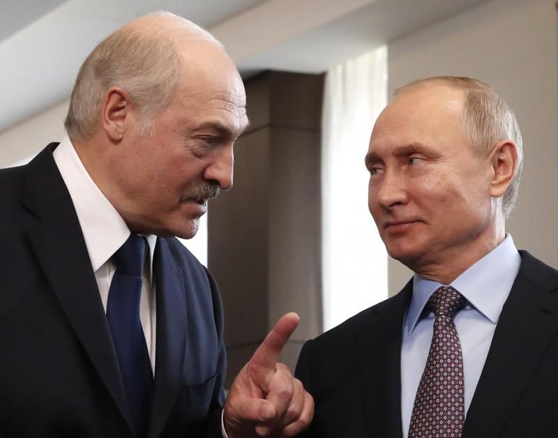 白俄羅斯總統魯卡申柯(左)與俄羅斯總統普廷(右)。(美聯社)