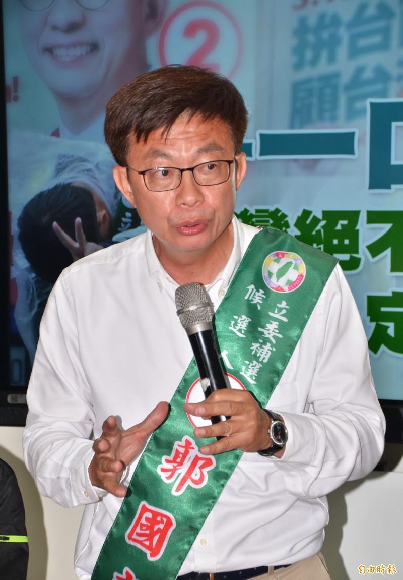 民進黨立委候選人郭國文抨擊藍營對手,複製「韓流」來糟蹋台南。(記者吳俊鋒攝)