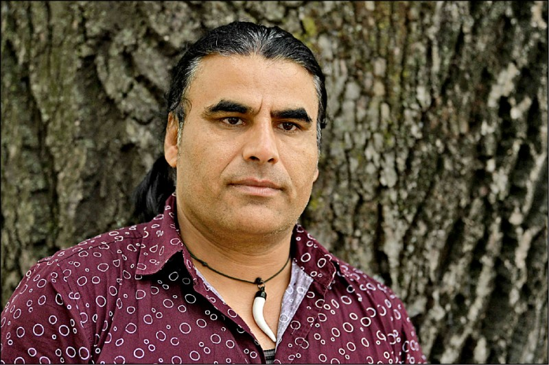 四十八歲的阿富汗難民阿濟茲,被視為紐西蘭濫射悲劇中的英雄。(法新社)