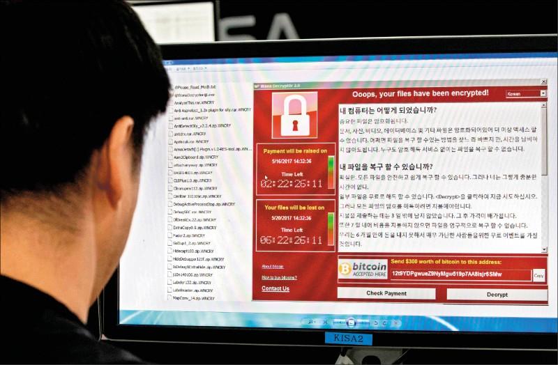 日本防衛省將開發其首款電腦病毒,相關惡意軟體將於二○一九年度完成編製。(法新社資料照)