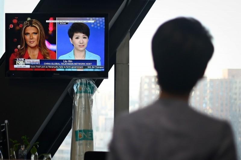 中國官媒央視旗下英語頻道《中國環球電視網》主播劉欣認為,愛不愛國與國籍無關。(法新社)