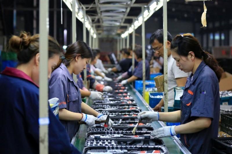 中國代工生產線因應美中貿易戰影響,開始讓員工分批放假。(路透資料照)