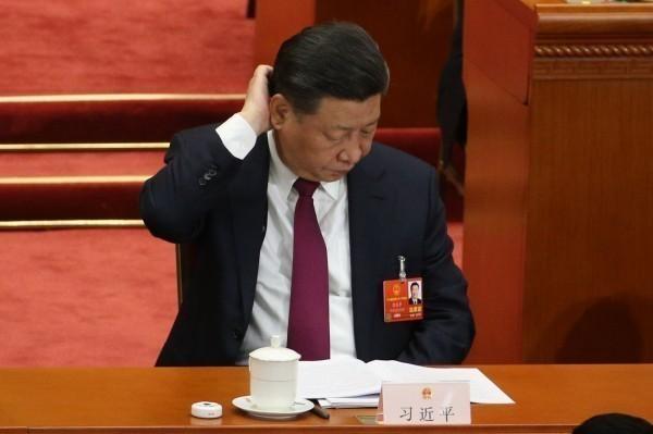 中國領導人習近平推動的一帶一路計畫出包,資金被哈薩克銀行業者吃掉。(歐新社)