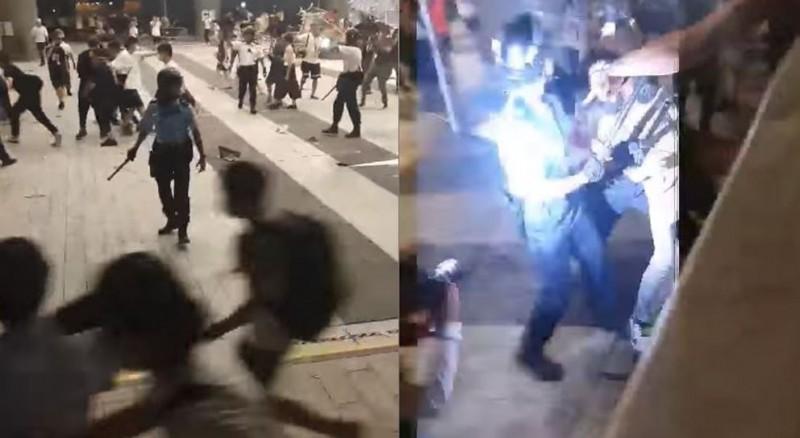 香港警方以武力驅散立法會大樓群眾,甚至阻擋民眾拍攝警方的暴力行為。(圖擷取自影片)