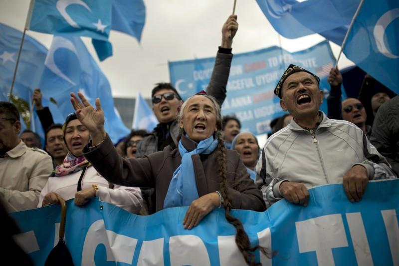 熱比婭(中)預計會在G20高峰會期間抗議中國政府侵犯人權的行為。(美聯社)