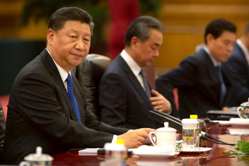 中國國家主席習近平(左一)。(法新社)