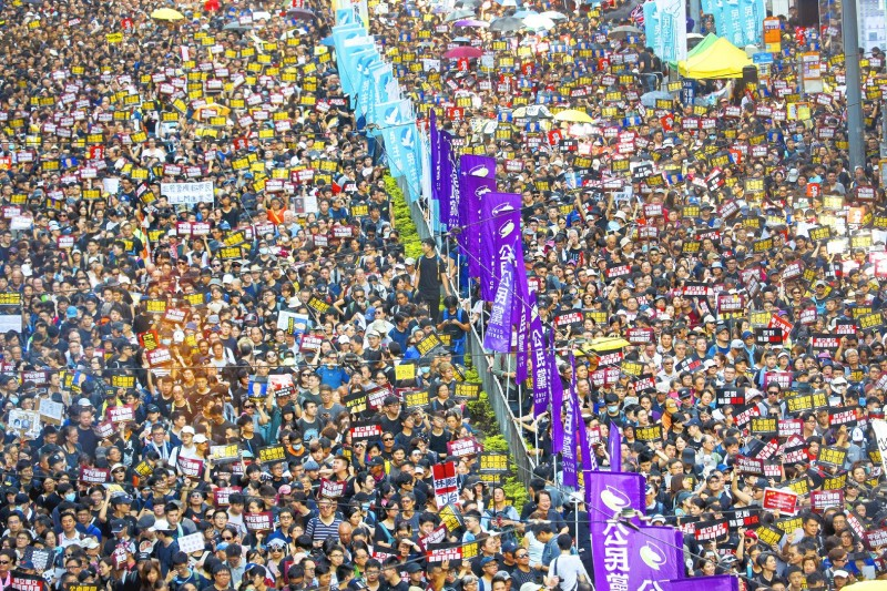 Protesters march in Hong Kong yesterday. Photo: AP