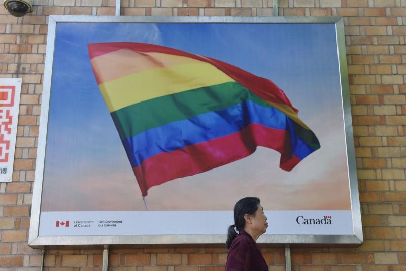 中國首都北京市近日完成第一例同性伴侶監護公證。(法新社)