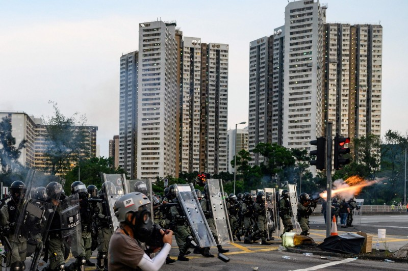 13歲的張同學認為,經過濫捕事件後「完全對香港警察失去信心」。(法新社)