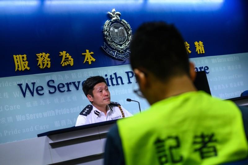 今日香港警方在記者會上,遭到大批中國官媒質疑,為何香港警方沒有在第一時間到場執法。(法新社)