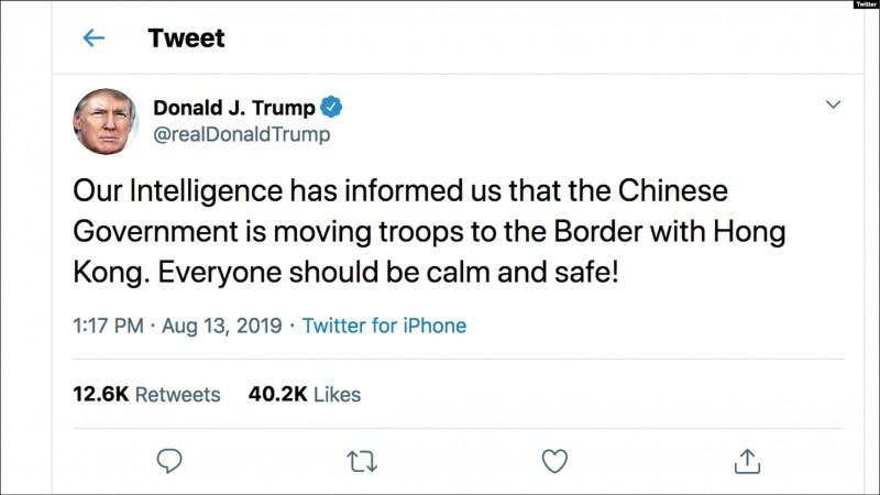 川普13日推文稱中國部隊正調往香港邊界。(取自網路)