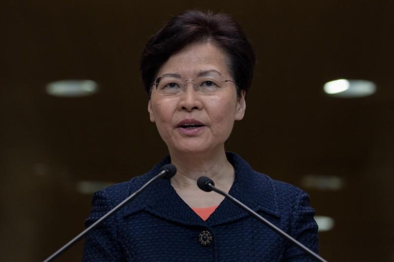 王丹認為,林鄭月娥宣布條例明年7月會自動失效是「以退為進」之計,呼籲香港民眾不要上當。(歐新社)