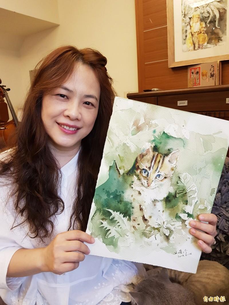 丘璦珍選出6幅石虎畫作印製成月曆義賣,所得捐做石虎保育。(記者彭健禮攝)
