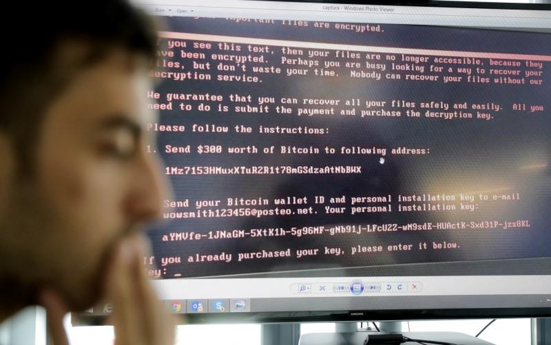 澳洲國會及多個政黨2月遭到駭客攻擊,調查報告指幕後黑手是中國國安部。(美聯社資料照)