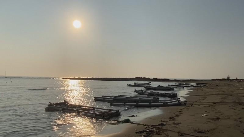 健走回程時還可見到金黃夕陽灑在海面上的醉人美景。(記者鄭名翔翻攝)