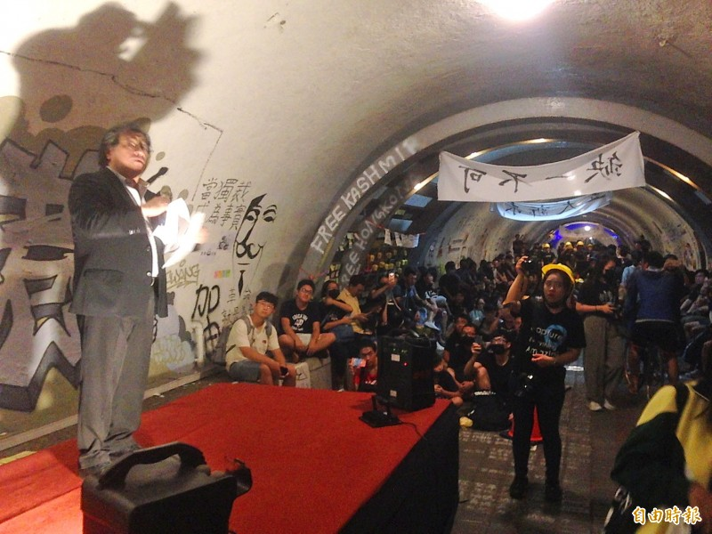 "Students attend the inauguration of a ""Lennon wall"" in the Sizihwan Tunnel at Sun Yat-sen University in Kaohsiung in an undated photograph. Photo: Huang Hsu-lei, Taipei Times"