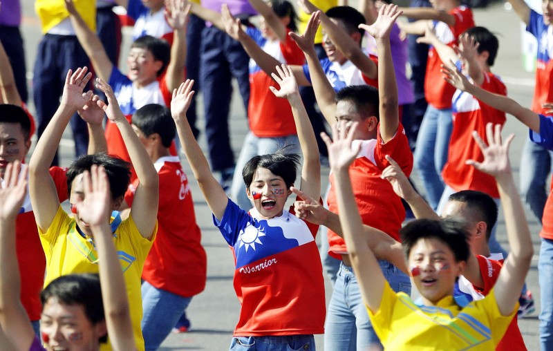 Dancers perform during the Double Ten National Day ceremony in front of the Presidential Office Building in Taipei yesterday. Photo: Chiang Ying-ying, AP
