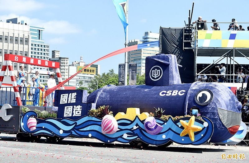 A float with a model of the nation's first indigenous submarine drives past during yesterday's Double Ten National Day parade in Taipei. Photo: Chien Jung-fong, Taipei Times