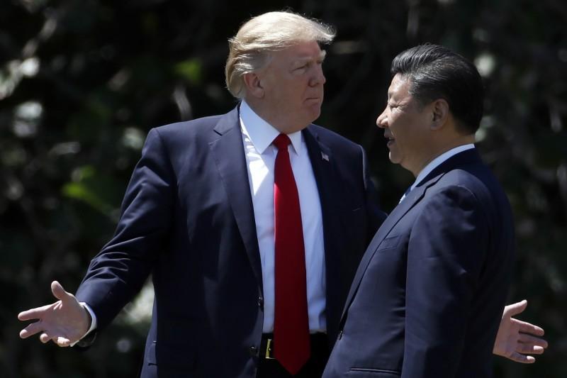 曾任職於國防安全研究院與國家安全會議的獨立分析師普麟(Victor Lin Pu)投書於《外交家》雜誌(The Diplomat),指出台灣政府在美中科技戰(technology war)衝突下的獲利空間。圖為美國總統川普與中國領導人習近平。(美聯社)