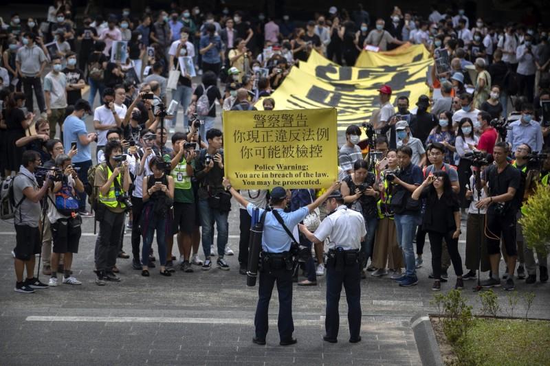 香港警方指稱民陣遊行內部「有鬼」因此否決明日遊行的議案。(美聯社資料照)