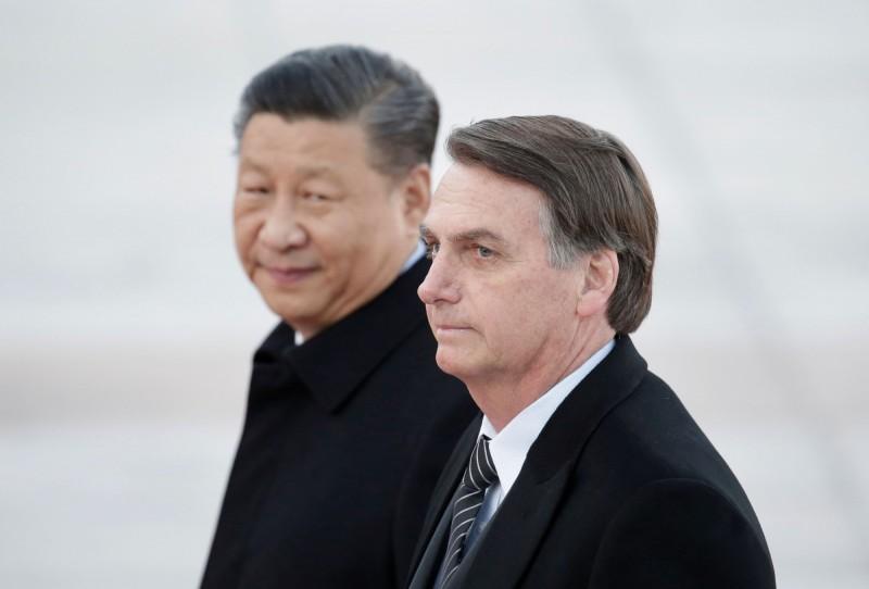 巴西總統波索納洛(Jair Bolsonaro)25日訪中,與中國國家主席習近平會面。(路透)